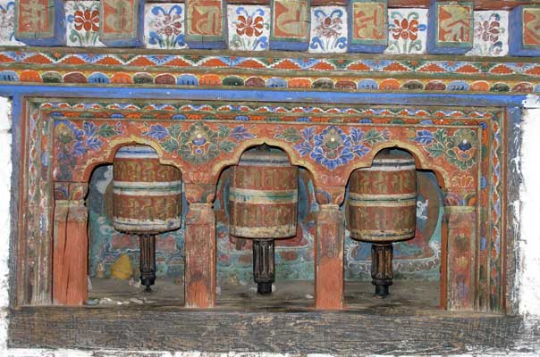 Prayer wheels around the temple