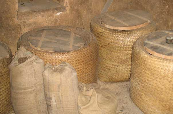 Grains in bamboo containers and gunny bags