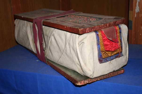 Book covered with cloth and wooden boards